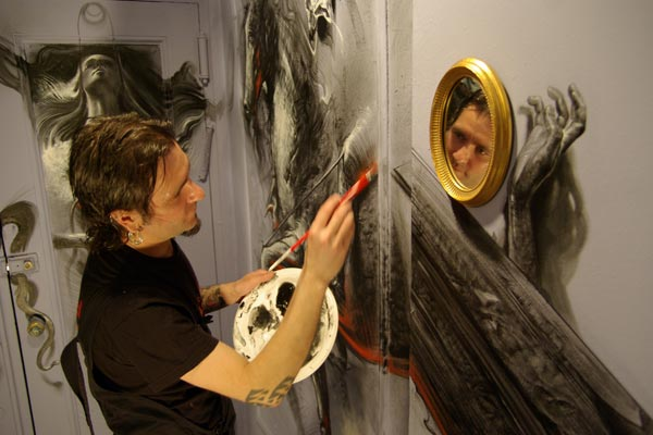 art-project-continues-at-carlton-arms-hotel-tattoo-artist-robert-hernandez-painting-in-2009